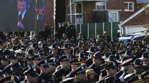 Hundreds of NYPD officers turn their backs on Mayor Bill de Blasio at funeral of fallen officer Rafael Ramos.