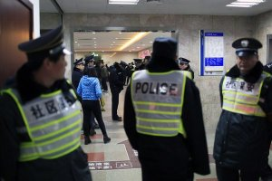 Security personnel and police officers at a Shanghai hospital where victims were treated on New Year's Day (Reuters)