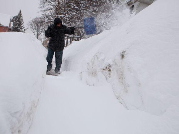 Man shoveling in Dorchester neighborhood, Feb. 9, 2015
