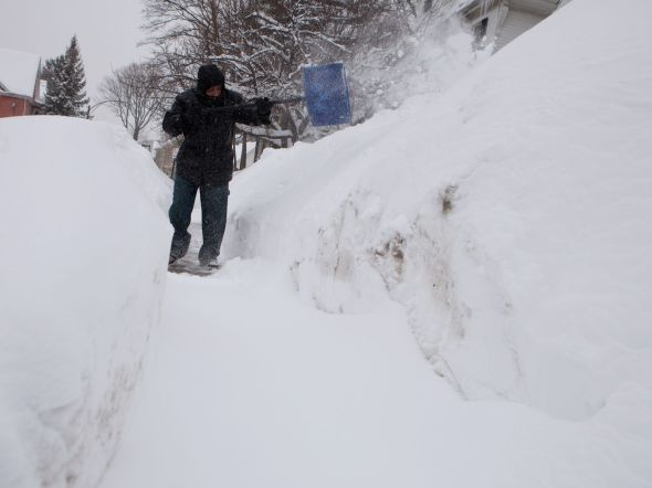 Man shoveling in Dorchester neighborhood, Feb. 9, 2015