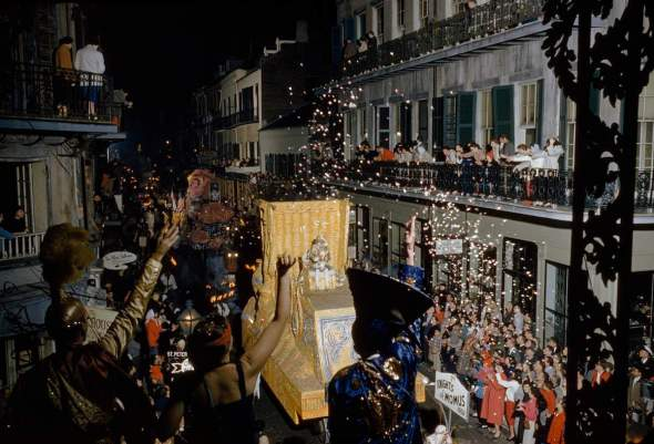 Revelers toss confetti at float of Momus, patron god of Mardi Gras, in New Orleans in 1960.