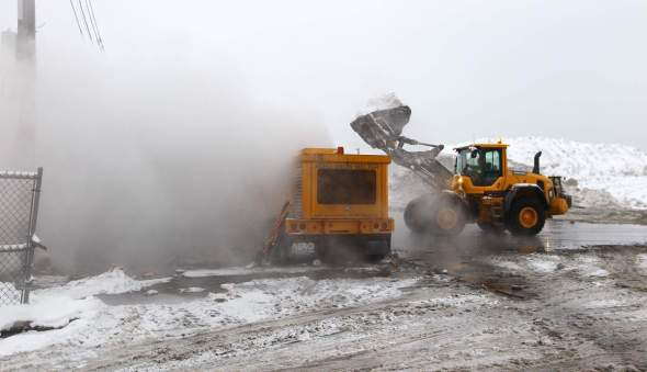 BOSTON - FEBRUARY 8: Crews use an Aero Snow Melter to dispatch mounds of snow at the Marine Industrial Park snow farm on February 8, 2015. (Photo by Pat Greenhouse/The Boston Globe via Getty Images)