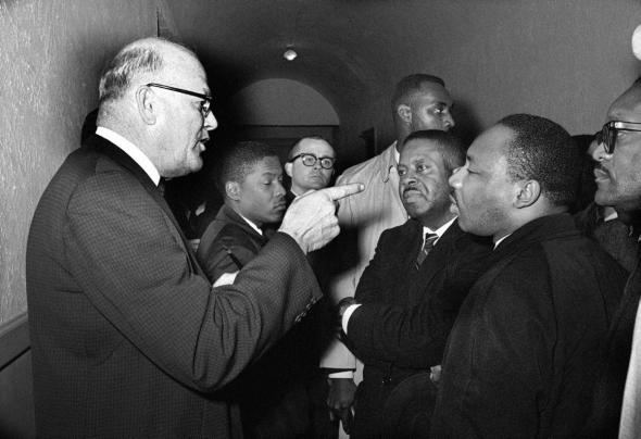 March 1, 1965, Registrar Carl Golson shakes finger in MLK's face saying that voter registration in Lowndes Cty is none of his business.