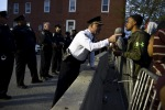 Captain Erik Pecha of the Baltimore Police Department chats with a young demonstrator during a protest against the death in police custody of Freddie Gray inBaltimore