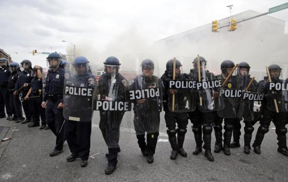 Baltimore police confront violent protesters