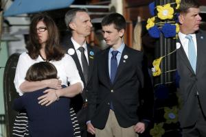 The family of Boston Marathon bombing victim Martin Richard  joins Boston Mayor Marty Walsh (R) at a ceremony at the site of the second bomb blast on the second anniversary of the bombings in Boston, Massachusetts April 15, 2015.   REUTERS/Brian Snyder