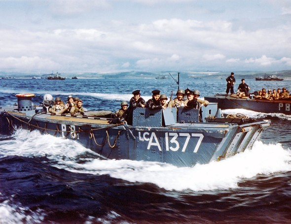 British Navy Landing Crafts (LCA-1377) carry United States Army Rangers to a ship near Weymouth in Southern England on June 1, 1944. British soldiers can be seen in the conning station. For safety measures, U.S. Rangers remained consigned on board English ships for five days prior to the invasion of Normandy, France.  (Photo by Galerie Bilderwelt/Getty Images)
