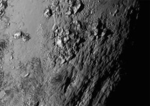 New close-up images of a region near Pluto's equator reveal a giant surprise: a range of youthful mountains. NASA-JHUAPL-SwRI