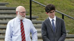 Recent St. Paul's School graduate Owen Labrie, right, stands with one of his lawyers, J.W. Carney, as jurors view the school grounds, Tuesday, Aug. 18, 2015, in Concord, N.H. (AP Photo/Jim Cole, Pool)