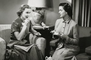 Two young women drinking tea --- Image by © SuperStock/Corbis