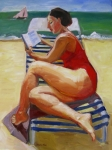 Woman at the beach reading
