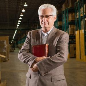 Hobby Lobby CEO David Green holding a bible.