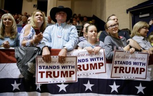 Audience members listen as Republican presidential candidate Donald Trump speaks during a campaign stop at the Burlington Memorial Auditorium, Wednesday, Oct. 21, 2015, in Burlington, Iowa. (AP Photo/Charlie Neibergall)