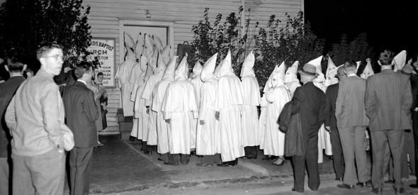 Klansmen file into an Atlanta church in 1949 to attend Sunday evening services