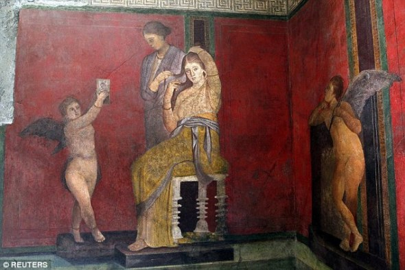 One of the frescoes that has been restored to its former glory at the Villa of the Mysteries at the ancient archaeological site of Pompeii.