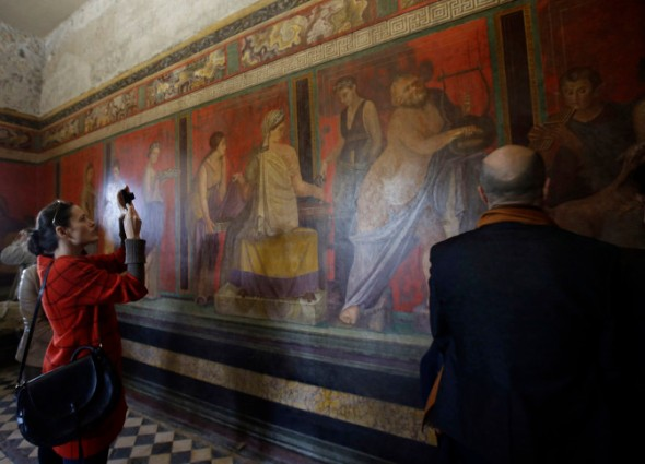 Journalists take photos of frescoes of the newly restored Villa of Mysteries in March 2015 (AP Photo/Gregorio Borgia)