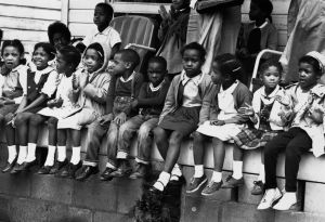 March 1965: Children watching a black voting rights march in Alabama. Dr Martin Luther King led the march from Selma, Alabama, to the state capital in Montgomery. (Photo by William Lovelace/Express/Getty Images)