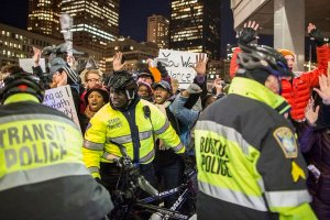 Boston police clash with protesters at City Hall Plaza in December 2014