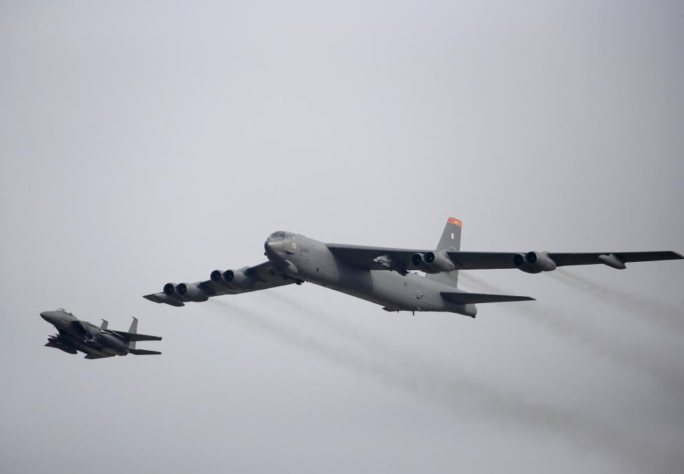 A U.S. Air Force B-52 (R) flies over Osan Air Base in Pyeongtaek, South Korea, January 10, 2016. REUTERS/Kim Hong-Ji