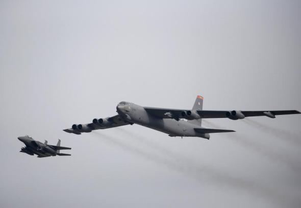 A U.S. Air Force B-52 (R) flies over Osan Air Base in Pyeongtaek, South Korea, January 10, 2016. REUTERS/Kim Hong-Ji