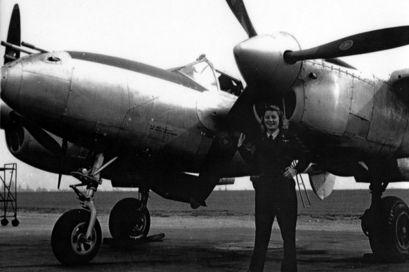 Nancy Batson Crews, among the first women to advocate for WASPS to be recognized as veterans in the early 1970s, is shown with a P-38.