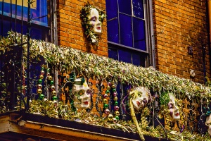 Mardi Gras decorations on a Bourbon Street balcony, French Quarter, New Orleans, Louisiana USA