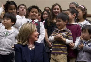 U.S. Secretary of State Hillary Rodham Clinton greets the children of U.S. Embassy employees at the embassy in Tokyo Sunday, April 17, 2011. Clinton is on a brief visit to Tokyo intended as a morale boost to the crucial U.S. ally. (AP Photo/Saul Loeb, Pool)