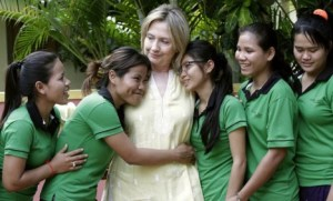 REFILE - CORRECTING SPELLING U.S. Secretary of State Hillary Clinton is greeted by human trafficking victims Van Sina (2nd L) and Somana (3rd R) at the Siem Reap AFESIP rehabilitation and vocational training center October 31, 2010. Clinton's visit to Cambodia is the first by a U.S. Secretary of State since 2003. REUTERS/Chor Sokunthea (CAMBODIA - Tags: POLITICS)