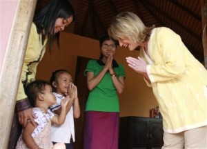U.S. Secretary of State Hillary Rodham Clinton, right, greets Cambodian children during her visit to a shelter for victims of sexual exploitation in Siem Reap about 230 kilometers (140 miles) northwest of Phnom Penh, Cambodia, Sunday, Oct. 31, 2010. Clinton was in the midst of a two-week, seven-nation tour of the Asia-Pacific. (AP Photo/Heng Sinith)