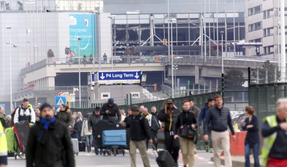BRUSSELS, BELGIUM - MARCH 22: Passengers are evacuated from Zaventem Bruxelles International Airport after a terrorist attack on March 22, 2016 in Brussels, Belgium. At least 13 people are though to have been killed after Brussels airport was hit by two explosions whilst a Metro station was also targeted. The attacks come just days after a key suspect in the Paris attacks, Salah Abdeslam, was captured in Brussels. (Photo by Sylvain Lefevre/Getty Images)