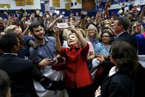 Democratic U.S. presidential candidate Hillary Clinton takes a selfie with supporters at a campaign rally at Carl Hayden Community High School in Phoenix, Arizona March 21, 2016. REUTERS/Mario Anzuoni MARIO ANZUONI / Reuters