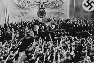 For comparison: Ovation for Hitler in the Reichstag after announcing the successful Anschluss, 1938