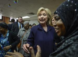 Hillary Clinton tours public housing building in Harlem yesterday.