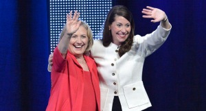 Former U.S. Secretary of State Hillary Rodham Clinton, left. and Kentucky U.S. Democratic senatorial candidate Alison Lundergan Grimes wave to supporters during a campaign rally, Wednesday, Oct. 15, 2014, at the Kentucky International Convention Center in Louisville, Ky. (AP Photo/Timothy D. Easley)