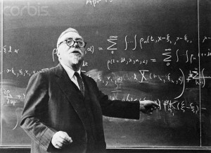 ca. 1958, Cambridge, Massachusetts, USA --- Dr. Norbert Wiener Standing at Blackboard --- Image by © Bettmann/CORBIS
