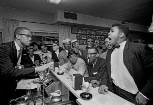 Ali joking around with Malcolm X in 1964