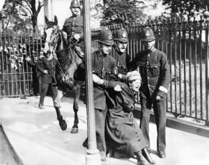 campaigning-suffragette-being-restrained-by-policemen-5-july-1910