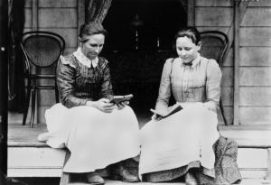 StateLibQld_1_132733_Two_women_reading_on_a_verandah_at_Ingham,_ca._1894-1903