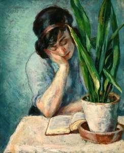 Woman reading with mother-in-law's tongue