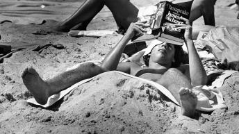 a-college-student-lays-on-fort-lauderdale-beach-while-reading-chesapeake-by-james-a-michener-march-17-1979