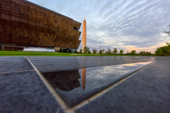 The first direct morning sun paints the Washington Monument a shade of red near the Smithsonian Institute''s National Museum of African American History and Culture in Washington, DC. MUST CREDIT: Washington Post photo by Jahi Chikwendiu
