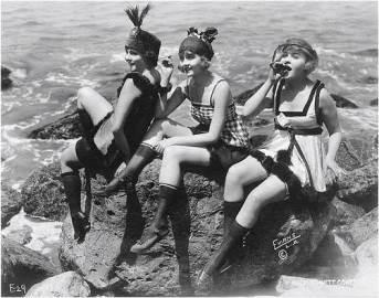 play-flappers-on-rocks-beach-vintage-women-fun