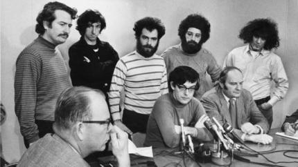 Defendants in the Chicago Seven conspiracy trial hold a news conference in Chicago on Jan. 5, 1970. Standing are, from left, John Froines, Tom Hayden, Jerry Rubin, Lee Weiner and Abbie Hoffman. Seated are Rennie Davis, center, and David Dellinger. (Chicago Tribune)