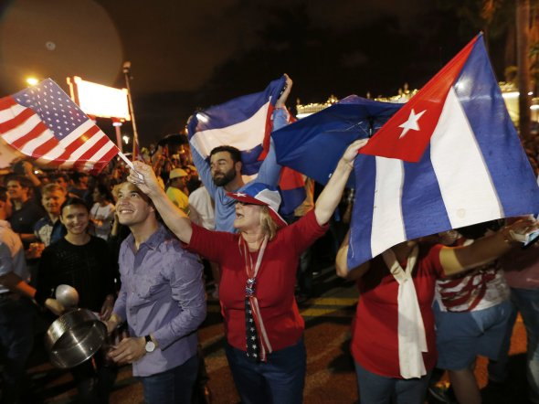 Cuban-Americans celebrate upon hearing about the death of longtime Cuban leader Fidel Castro in the Little Havana neighborhood of Miami, Fla., on Saturday. AFP/AFP/Getty Images