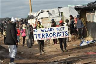 refugees-demonstrating-in-migrant-camp-in-france