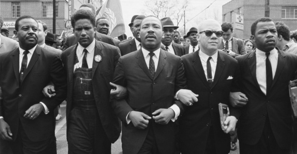 John Lewis marching from Selma to Montgomery with Dr. Martin Luther King and other Civil Rights leaders.