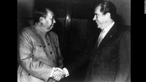 Chinese communist leader Chairman Mao Zedong (1893 - 1976) shakes hands with American president Richard Nixon (1914 - 1994) in Peking (Beijing) during his visit to China. (Photo by Keystone/Getty Images)