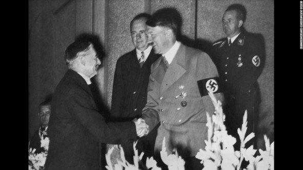 German dictator Adolf Hitler shakes hands with British Prime Minister Neville Chamberlain at Hotel Dressen in Godesberg, 22nd September 1938. The two met to discuss the German occupation of Sudetenland. (Photo by Keystone/Hulton Archive/Getty Images)