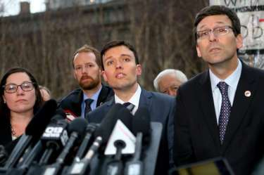 Solicitor General Noah Purcell (C) and Washington state Attorney General Bob Ferguson (R) speak at a press conference outside U.S. District Court, Western Washington, on Feb. 3, 2017
