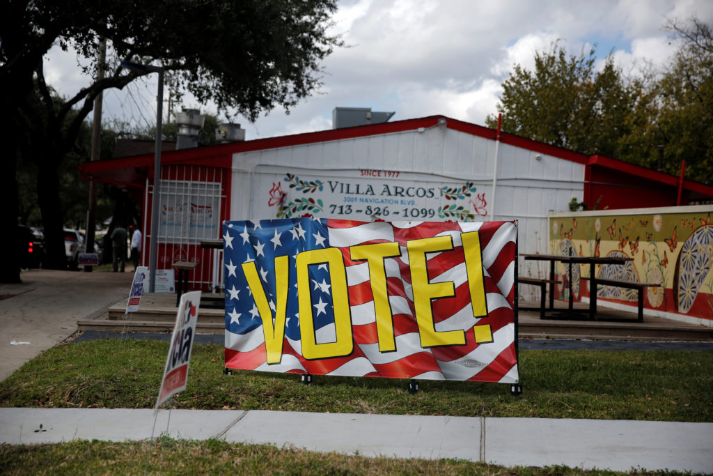 A banner urging people to vote in the midterm elections is displayed in Houston